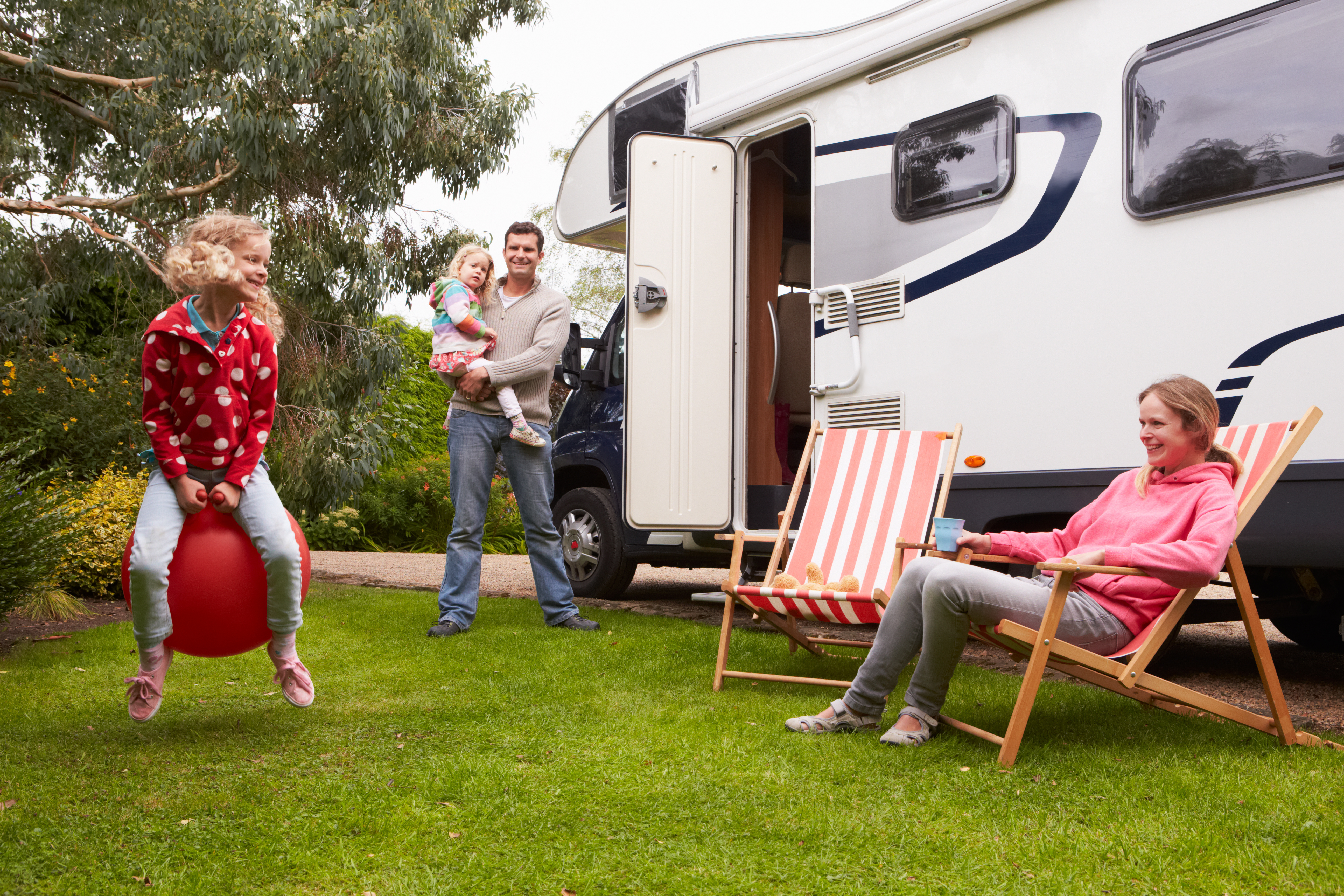 Family enjoying their new RV at the campground